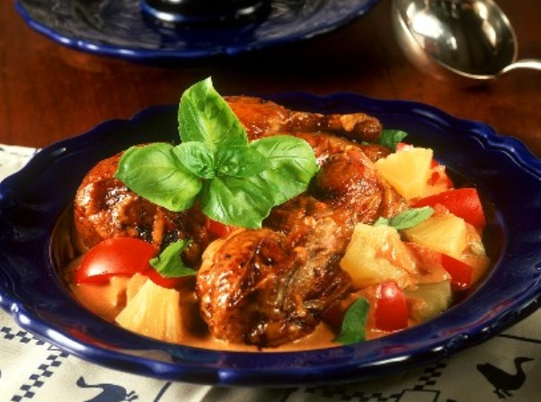 Glazed duck in red curry sauce with pineapple and tomato